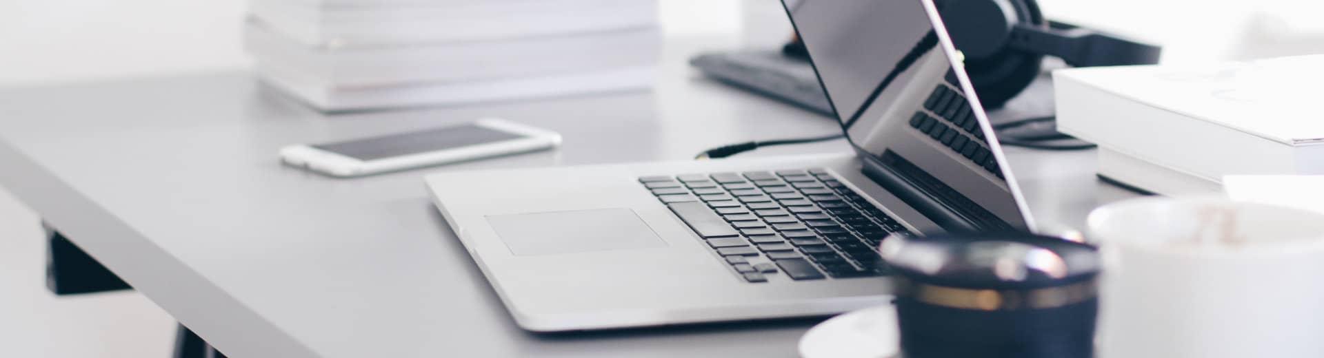 subheader_contributors_laptop_on_table