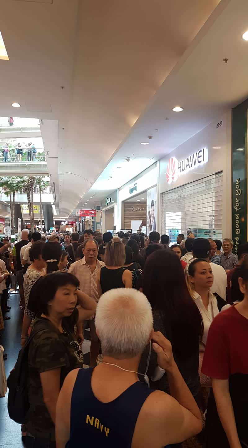 Crowd outside Huawei Jurong Point