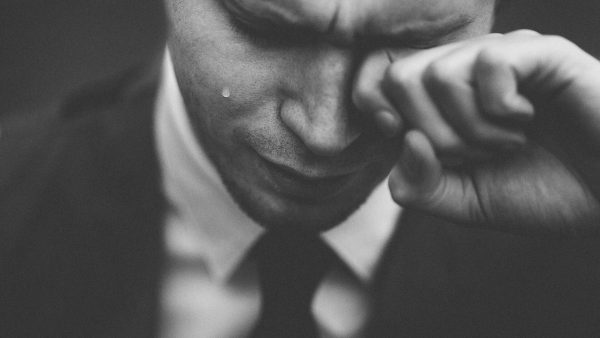 depressed man in suit crying