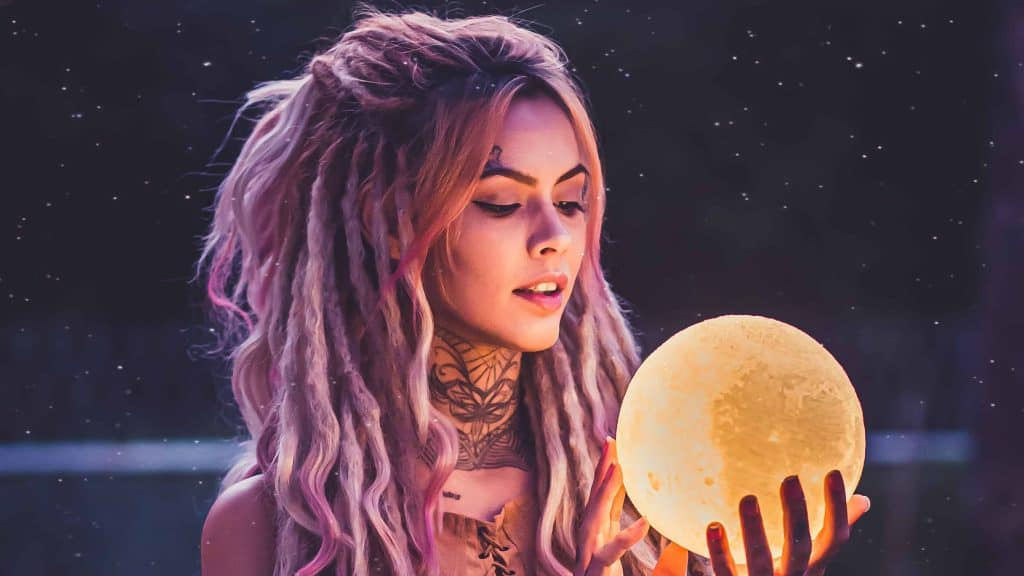 woman holding 3d moon lamp prediction