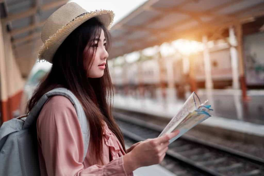 asian girl wearing pink blouse and hat