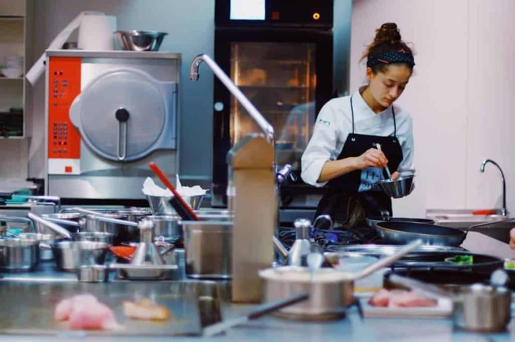 Female staff working in kitchen