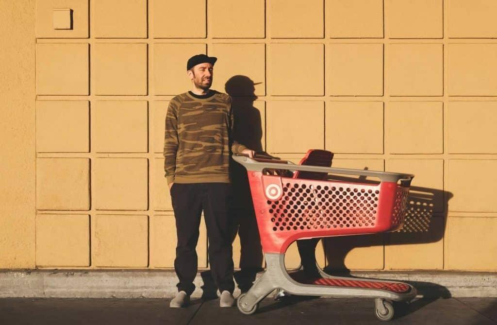 man trolley shopping financial goals