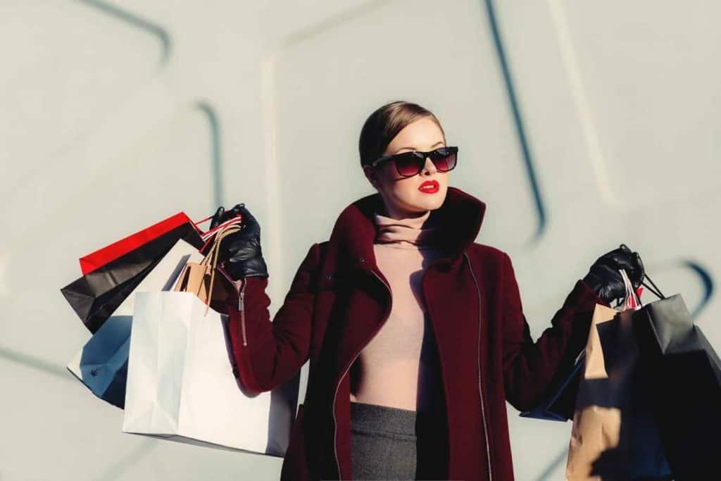 woman carrying shopping bags financial goals